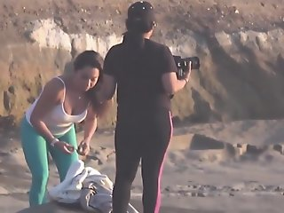 Latina on the beach in spandex